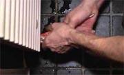 Radiator loskoppelen en terughangen